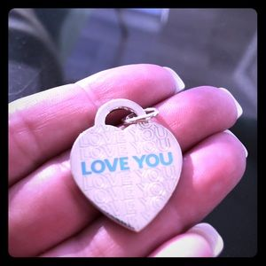 """Tiffany & Co sterling silver """"LOVE YOU""""pendant."""
